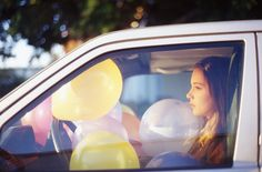 by Oliver Bryce Yates. #balloons #car #sunset