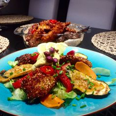 Coconut flake chicken fingers with noodle salad and manchego cheese zucchinies