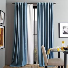 Blackout Curtain, the white curtain under the blue.  from West elm