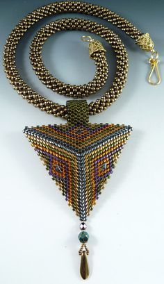 Crocheted rope necklace with geometric peyote pendant by The Beaded Swan.