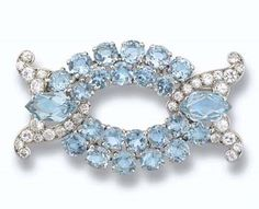 CARTIER Princess Margaret's Cartier Aquamarine and Diamond Brooch.  London in 1932 and purchased by HM QE, Queen Mother on January 23, 1947 for £175.  Designed as an openwork oval plaque of circular-cut aquamarines to a hexagonal aquamarine and circular-cut diamond scroll shoulders, mounted in platinum.  Approximately 5.1 cm wide.  Sold at Christie's auction in 2006 for $121,440, US.  https://www.facebook.com/groups/260713314096465/