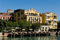 Hotel Sirmione - Sirmione ... Garda Lake, Lago di Garda, Gardasee, Lake Garda, Lac de Garde, Gardameer, Gardasøen, Jezioro Garda, Gardské Jezero, אגם גארדה, Озеро Гарда ... Welcome to Hotel Sirmione, Hotel Sirmione offers a relaxing atmosphere, free nearby parking and a panoramic position in front of Lake Garda. Some rooms provide a free minibar and marina views. Hotel Sirmione faces the historic centre on one side, and the marina on the other. The hotel i