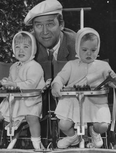 Jimmy Stewart with his twin-daughters - Judy and Kelly
