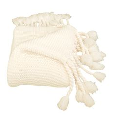 Perfect draped over the sofa or at the foot of your bed, this hand-knotted throw features a rich waffle weave and rope-style fringe.