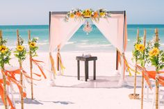 Cheery sunflower wedding beach wedding arbor.