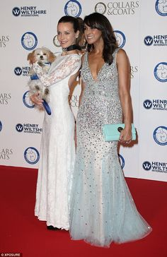 Wow factor: Jackie St Clair posed up a storm on the red carpet at Battersea Evolution with...