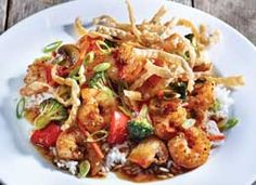 Stir-fry shrimp and veggies are tossed in a sweet and spicy dumpling sauce, served over a bed of rice and topped with wonton strips. Wonton Recipes, Stir Fry Recipes, Copycat Recipes, Applebees Shrimp Wonton Stir Fry Recipe, Seafood Recipes, Applebee's Menu, Food Menu, Drink Menu, Applebees Nutrition