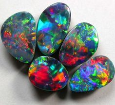 Opal doublet is a naturally appearing slice of opal that is matched with a black backing to improve the colour imitating the colours of black opal. Because of the enhanced backing doublets tend to be very beautiful stones but because they are not 'natural' they trade at a discount to many opals.