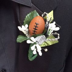 A football in a boutonniere adds a little fun.