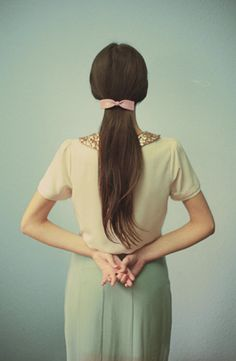 i could get behind a hair bow like this one, low and in back with length to balance out the kitsch...Chanel.