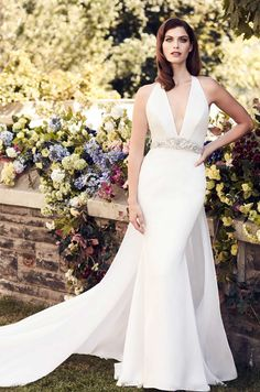 View Sophisticated Chiffon Train Wedding Dress - Style #4741 from Paloma Blanca. Paloma Satin gown with plunging neckline. Removable Chiffon train.