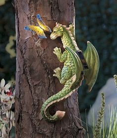 Mystical Solar Dragon And Butterfly This Solar Dragon is a spellbinding mix of color, light and outdoor fun. The ornately detailed climbling dragon with a beautiful butterfly accent adds enchantment to o. Magical Creatures, Fantasy Creatures, Fantasy World, Fantasy Art, Dragon Oriental, Dragon Tree, Dragon's Lair, Dragon Pictures, Dragon Images