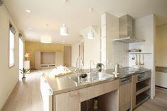 ステンレス天板とオーク材ホワイトオイル仕上げのオーダーキッチン