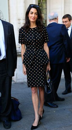 http://www.eonline.com/news/669283/spotted-amal-clooney-wears-polka-dot-dress-with-statement-pockets