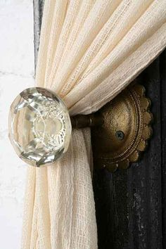 Door Knob Curtain Tie-Back - Urban Outfitters Such a simple idea. Decorative and functional, a chance to indulge in gorgeous door knobs!