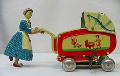 Vintage tin litho toy, mother pushing baby carriage / pram.