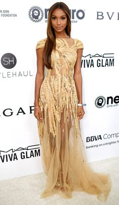 JASMINE TOOKES wears a golden Zuhair Murad gown with John Hardy and Csarite by Erica Courtney jewelry, plus gold Stuart Weitzman sandals at the Elton John AIDS Foundation Party.