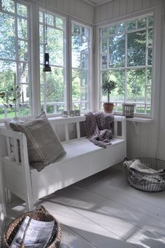 This just screams cottage. Love it all - white wide plank floors, windows, wall boards (although I want them horizontal), bench.