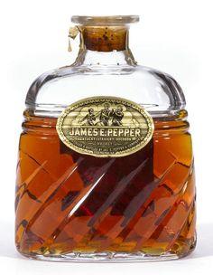 James E. Pepper Kentucky Straight Bourbon Whiskey Distilled fall 1946, bottled fall 1950.  Glass decanter, driven cork. Oval, gold foil label. Some wear to bottom of label. Back label torn. Level: Below shoulder. 4/5 Quart. 100 proof.
