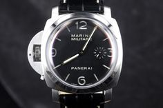 Panerai PAM 217 Luminor Marina Militare Destro 1950 SE 47mm Panerai PAM217 is a lefty version of the Pam 127 (fiddy) it's a limited edition from 2005. This is a very large 47 mm stainless steel case with a black dial with the 1950 case. The dial is sandwiched (2 layer) with luminova numbers as well as the second logo PANERAI. It has gold hands and a gold sub second hand that are just stunning against the black background. . Only 1000 units