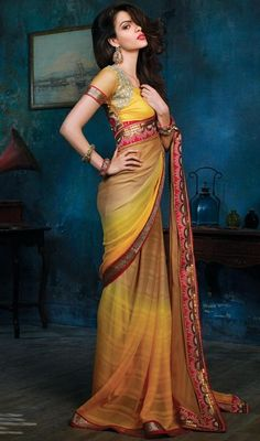 Exhibit the liveliness in your femininity dressed up in this beige and yellow color chiffon saree. The butta and zari work appears chic and best for any celebration. Upon request we can make round front/back neck and short 6 inches sleeves regular sari blouse also. #BeautifulBeigeChiffonBasedSari