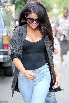 Feeling perky: Selena Gomez went braless in a sheer top for lunch at The Bedford in Williamsburg on July 9, 2014 http://dailym.ai/1jgJGrs
