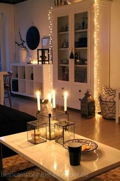 Cozy white home decor decorating white lights and candles