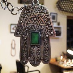 Get at https://jewelsarts.com/products/view/963-large-hamsa-charm-with-star-glass/necklaces