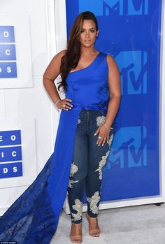 Mixing it up: Orange Is The New Black beauty Dascha Polanco teamed embellished jeans with a bold blue top with train