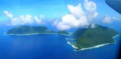 From the air, looking north to Ofu Island (left) and Olosega Island (right), Samoa. Once a single island like Ta?u, landslides and flank failures have sculpted this older volcano into two islands. An ankaramite dike collected on the north side of the small peak just west of the waterway between Ofu and Olosega gives the highest 3He/4He isotope value in Samoa. (Photo by Bob Greschke)