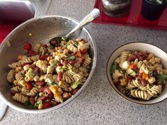 Pasta, corn, cucumbers, basil, tomatoes, fava beans, sweet peppers, chickpeas, avocado