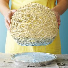 Step 10  Remove ball and trim any flyaway twine pieces.   Step 11  Pour 2 cups latex paint and 1 cup water in pie tin. Stir thoroughly. Dip twine lampshade in several two-second intervals until you reach the desired color. Be careful not to soften the water-base glue, which will cause the twine to loosen. Let dry.