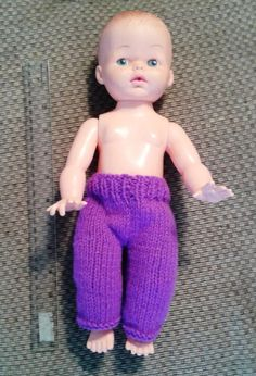 This doll is thinner and has straight legs.  Is roughly 14 inches tall.