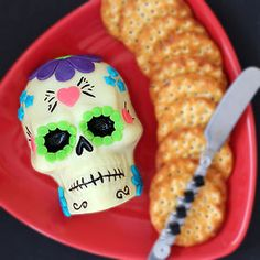 Can you believe this sugar skull is made out of CHEESE? A great Day of the Dead appetizer.