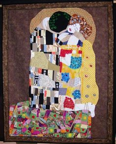"We couldn't resist this contemporary pictorial quilt: ""Sealed With A Kiss"" by Peggy Fairburn. Curved seams, stitch and flip, padded, folded and 3D patchwork appliqué, beading, fabric paints, piping, mitred corners, free motion quilting. Artist statement: ""A jigsaw of ""The Kiss"" a painting by Gustav Klimt. If only I could capture the passion in a quilt."""