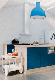 Colorful kitchen with blue cabinets and wooden tabletops.