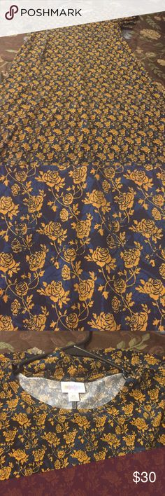LuLaRoe Carly Great condition. Laundered to LLR standards. Navy background with gold flowers LuLaRoe Dresses