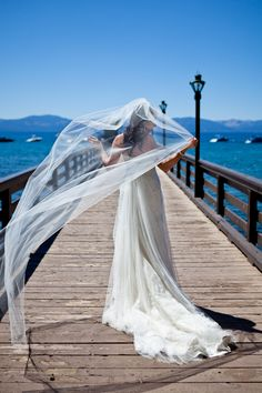 Mountain wedding, Lake Tahoe, pier shots. The weather and wind were perfect for that veil!  Jessi LeMay Photography