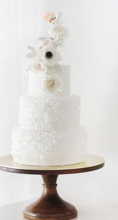 Featured Cake: Winifred Kristé Cake; Elegant textured white wedding cake with beautiful flowers on top