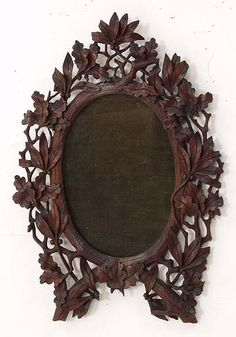 Black forest carved wood frame---I can totally picture this in a safari style setting.
