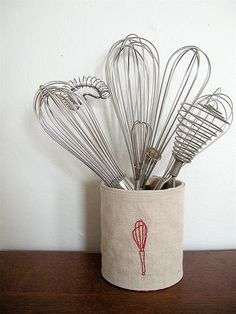 10 Ideas To Recycle Tin cans side note: how have I not been collecting whisks my whole life? So cute