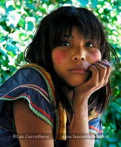 This indigenous woman is deep in thought!