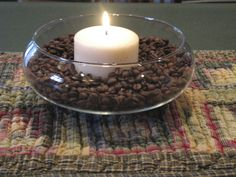Small clear bowl, vanilla coffee beans and vanilla candle, smells so good. (from inspirationfordecorating.blog)