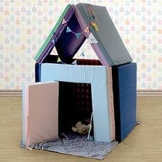 Multifunctional Playhouse. made from eco-friendly cotton cushions that can be unzipped and transformed into a gym mat, couch, or bed :D