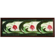 A relief moulded three tile panel, each with a tulip and swirled leaf design in red, light and dark green...
