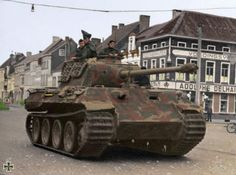 ":「A German ""Panzerkampfwagen V"" better known as the Panther tank, moves through a French village. The panther tank was a direct response to…」"