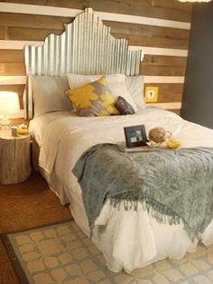 Cowgirl chic for the guest bedroom. I love the reclaimed fence pickets on the wall.