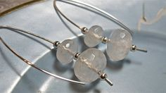 The wires are hand fabricated, hand hammered sterling silver with drops of faceted white quartz beads and sterling silver beads. They dangle 2 inches. $30