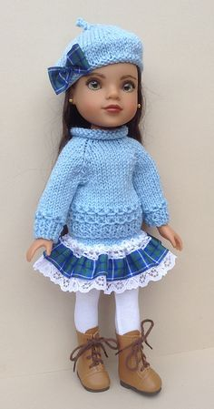 A lovely trio of sweaters and matching hats for 13 and 14 inch dolls. Knit the sleeves first and then introduce them to the armhole division of the main body which is knit all in one up to the armhole divide. knitted flat on 2 x 3.25mm needles using UK double knit yarn