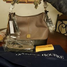 Last of the Dooney & Bourke Sophie hobo handbag Brand new with wallet and keychain last of the Sophie hobos as the item has been discontinued Bags Hobos